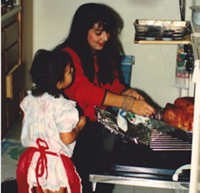 Helena cooking with Rachel when she was little